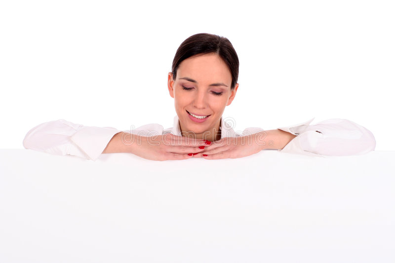 Woman leaning on a billboard royalty free stock image
