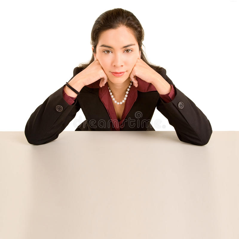 Woman Leaning On Desk While Looking At Camera Royalty Free Stock Images
