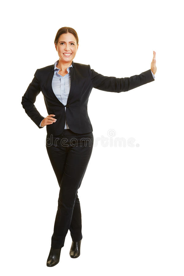 Woman leaning on imaginary wall stock photos