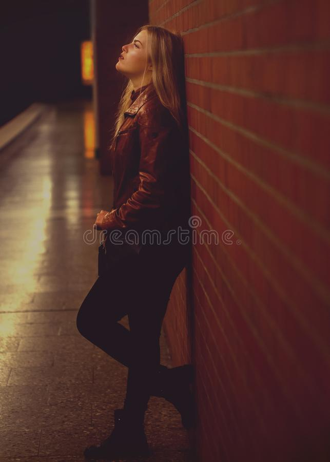 Woman Leaning On Wall royalty free stock images