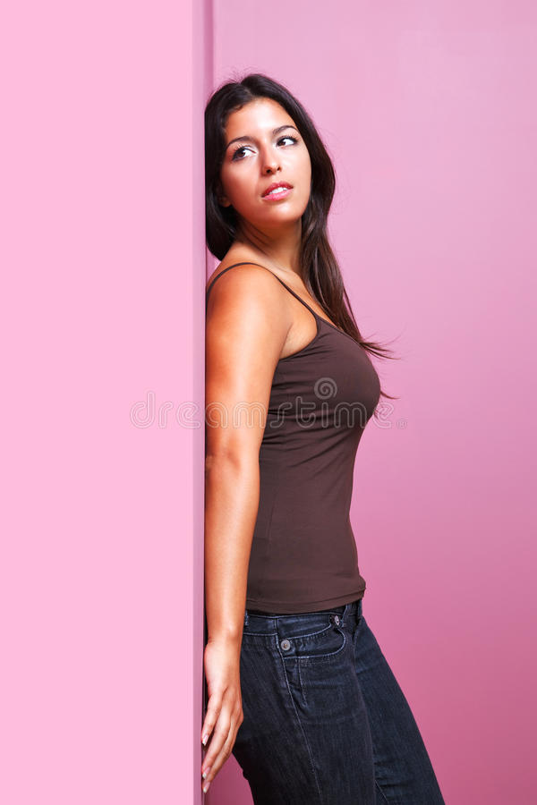 Woman leaning on a wall royalty free stock images