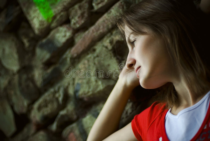 Woman leaning on wall stock photos