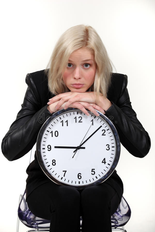 Download Woman Leaning On Wall Clock Stock Image - Image: 26959381