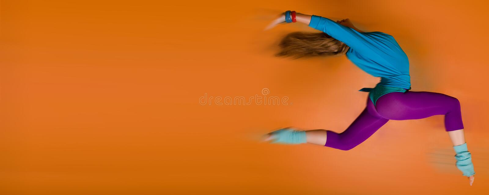 Download Woman Leaping Over Orange Background Stock Photo - Image: 9274074