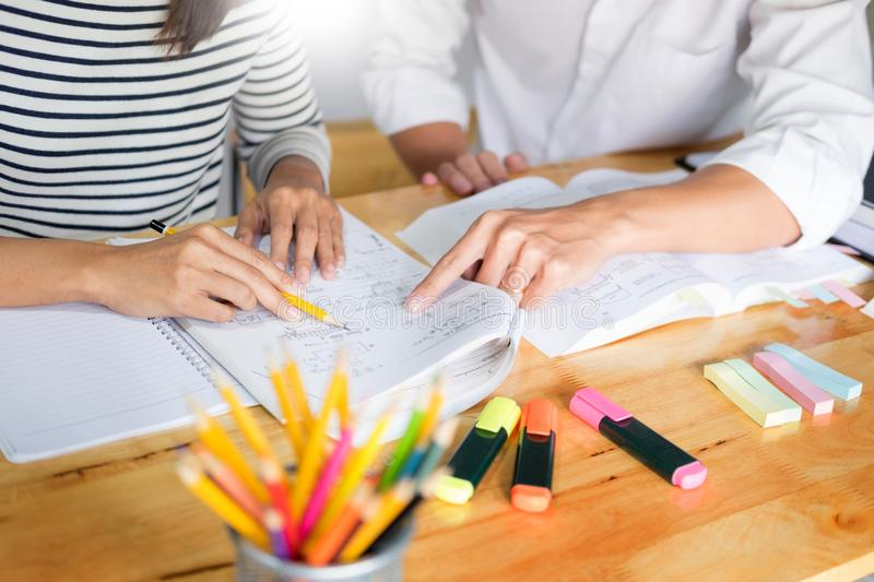 Woman learn and teach tutor concept education helping each othe. R sitting in a table at class room royalty free stock photos