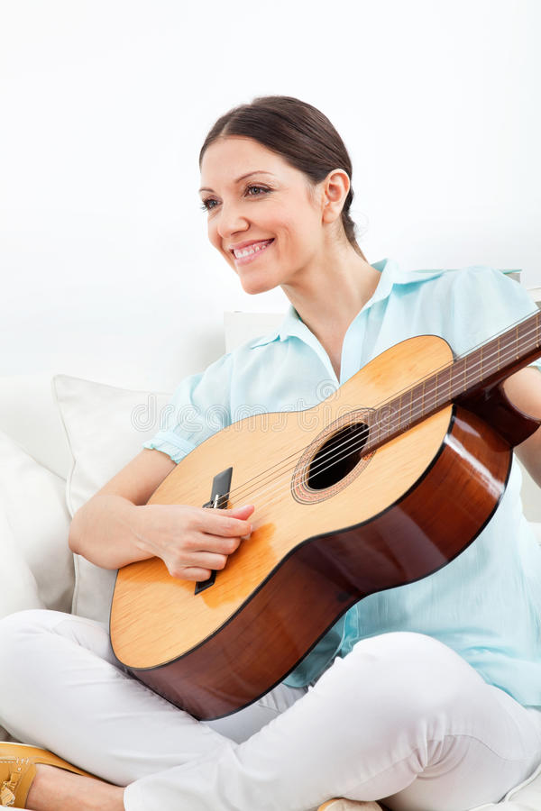 Woman Learning To Play Guitar Stock Images