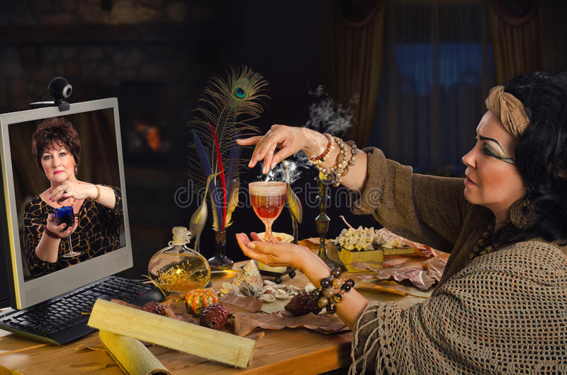 Woman learns online how to make a love-potion stock images