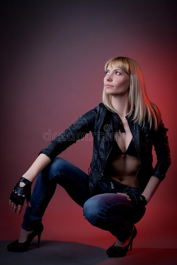 Woman In Leather Jacket And Jeans Stock Images