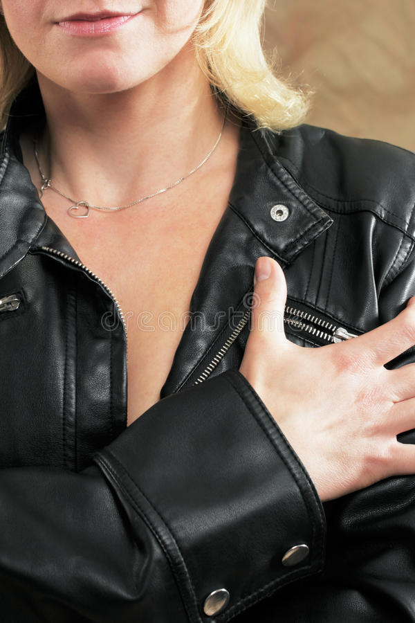 Woman with leather jacket and necklace royalty free stock images