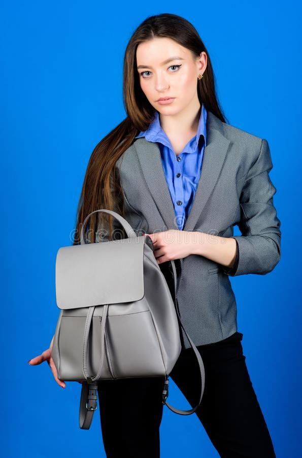 Woman with leather knapsack. Stylish woman in jacket with leather backpack. Formal style accessories. Backpack for daily. Modern urban life. Girl student in stock images
