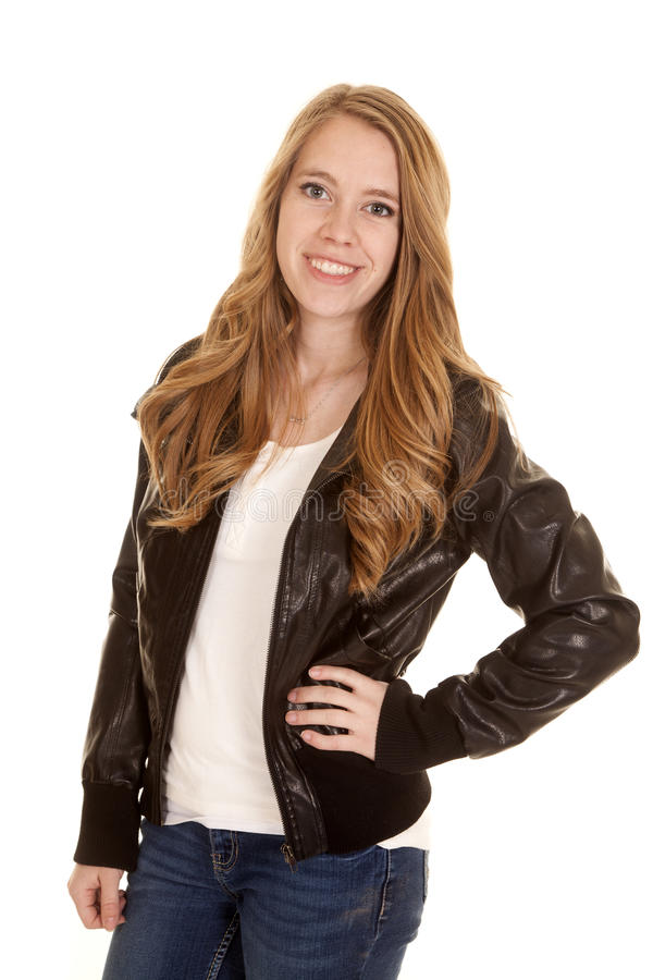 Woman leather stand smile stock image