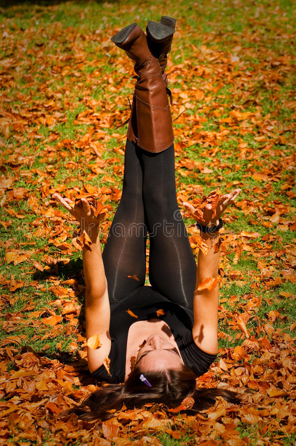 Woman on leaves stock photography