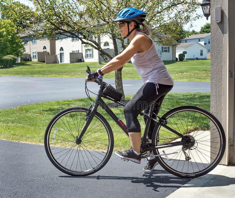 Woman Leaving for Bike Ride royalty free stock image