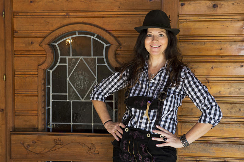 Woman in lederhosen and bavarian hat royalty free stock photography
