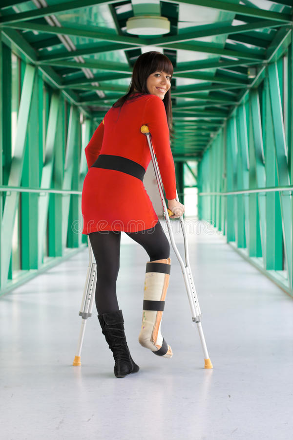 Woman with leg cast and crutches in hospital stock photos