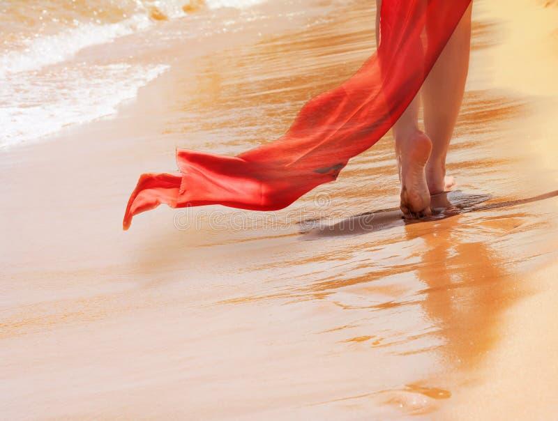 Woman leg with red veil stock photos