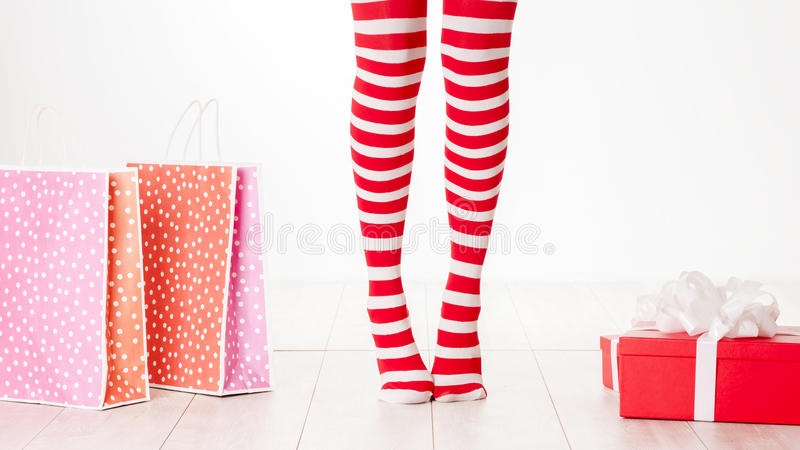 Woman legs in color red socks isolated on white royalty free stock image