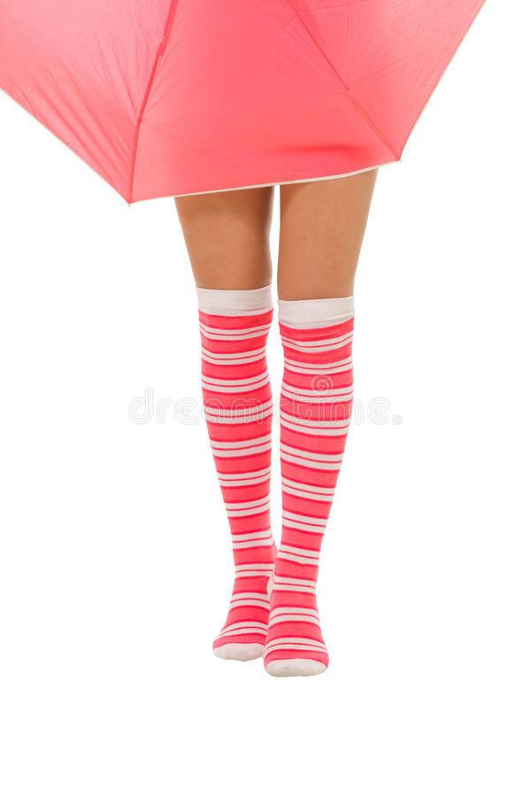 Download Woman Legs In Color Red Socks With Umbrella Isolat Stock Photos - Image: 10597443