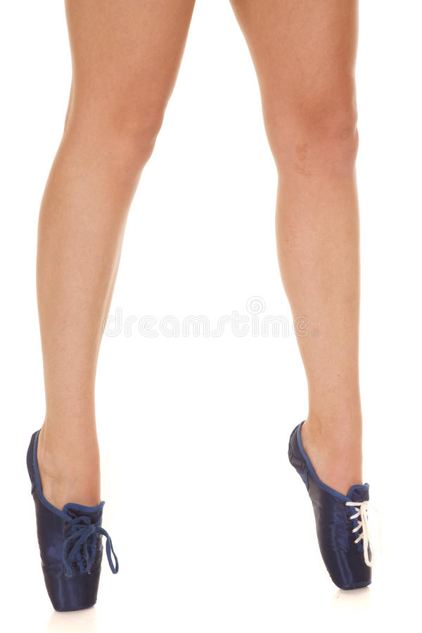 Woman legs dance shoes on toes. A woman is standing on her toes in her dance shoes stock image