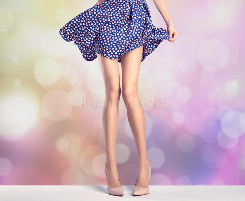 Woman legs in fashion dress and high heels, outfit stock photography