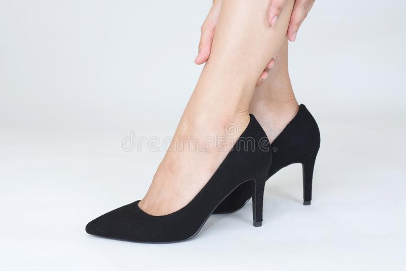 Woman legs in fashionable high heel shoes. Black high heel shoes on women's leg stock images
