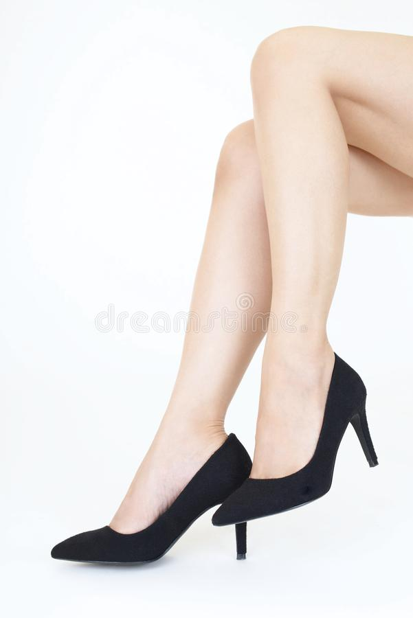Woman legs in fashionable high heel shoes. Black high heel shoes on women's leg royalty free stock photos