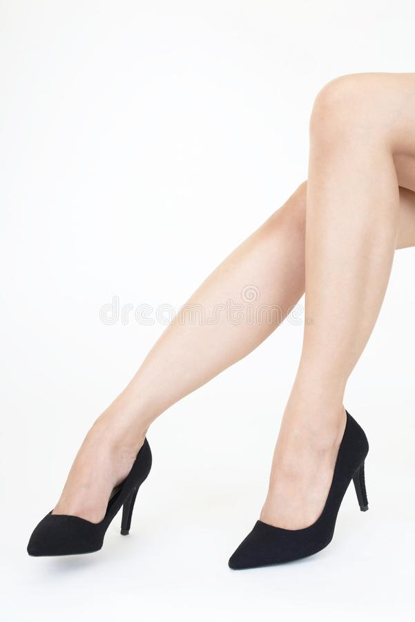 Woman feet wearing black heel shoes. Woman legs in fashionable high heel shoes stock images