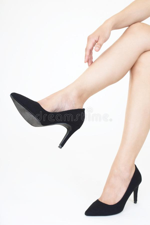Woman feet wearing black heel shoes. Woman legs in fashionable high heel shoes stock image