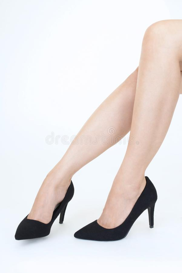 Woman feet wearing black heel shoes. Woman legs in fashionable high heel shoes royalty free stock photo