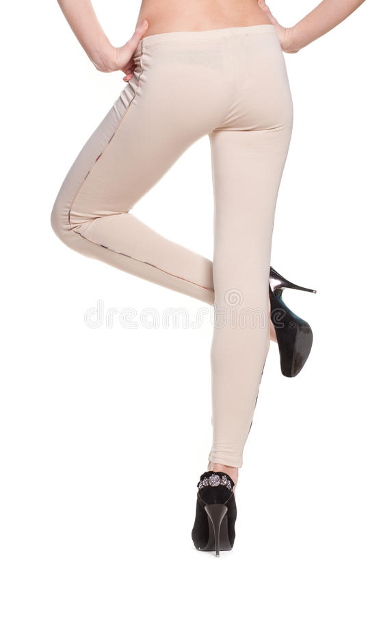 Woman Legs In Fawn Leggins And Black Shoes Royalty Free Stock Photography