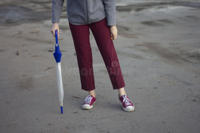 woman legs with her umbrella and rain coat, ready for the weather stock image