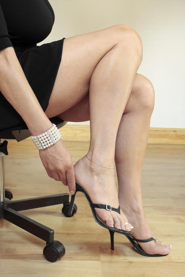 Woman legs with high heels stock photo