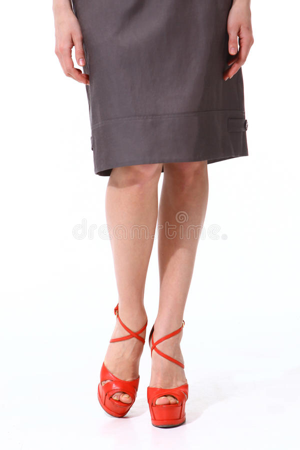 Woman legs in high heels red shoes stock image