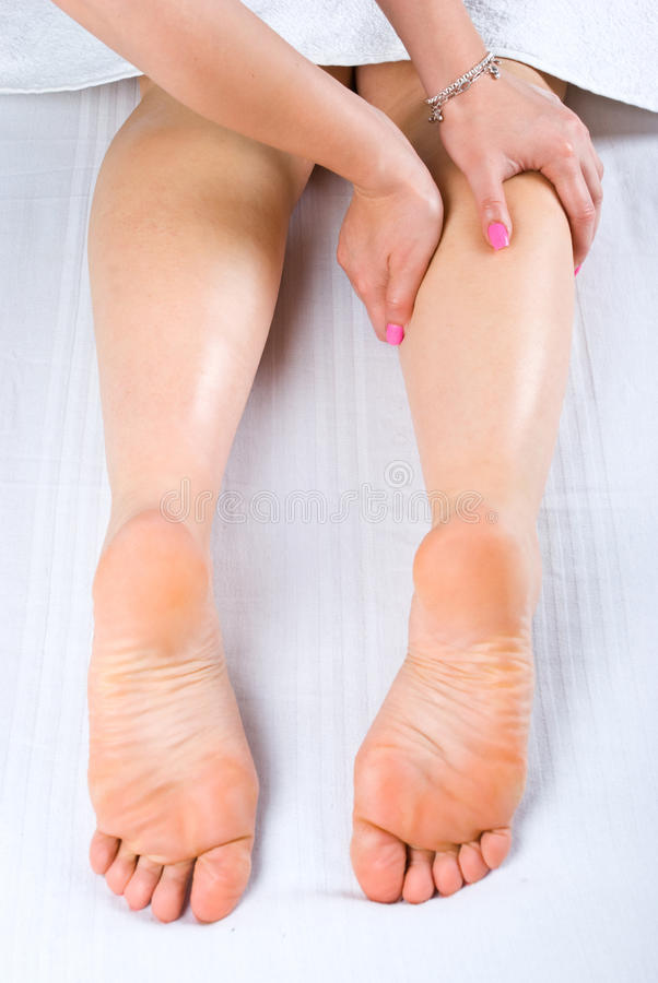 Woman legs massage royalty free stock photos