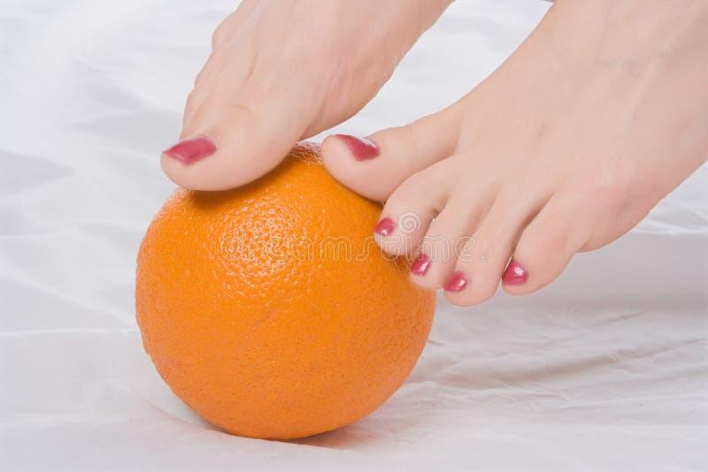 Woman legs with orange royalty free stock photos