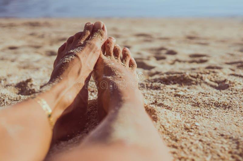 Woman legs on sand beach royalty free stock photography