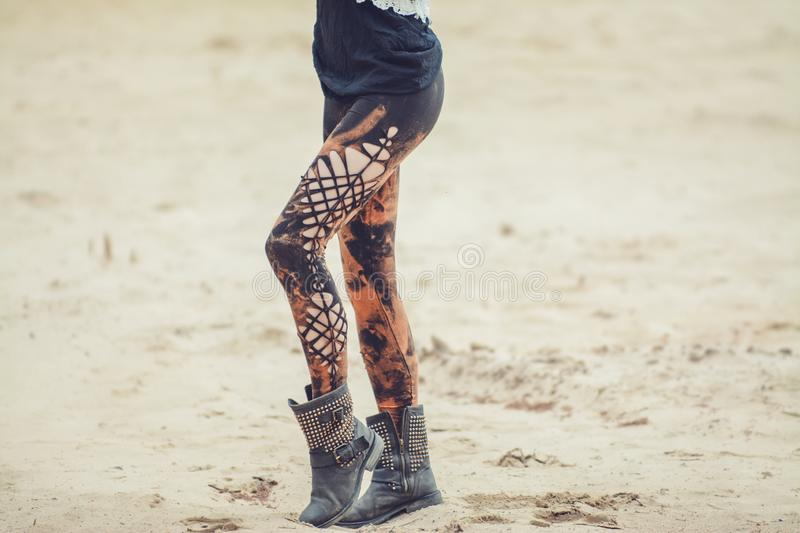 Woman legs in stylish and trendy leggings. Unique and beautiful, made of cotton stock photography