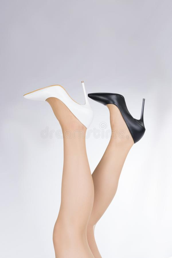 Woman with legs up and stiletto female shoes with high thin heels.  stock image