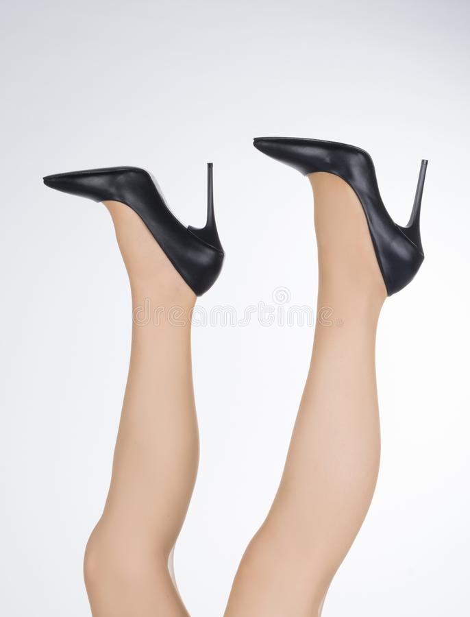 Woman with legs up and stiletto female shoes with high thin heels.  royalty free stock images