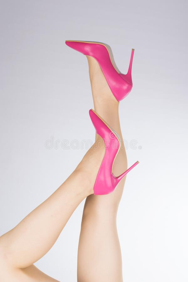 Woman with legs up and stiletto female shoes with high thin heels.  stock photography