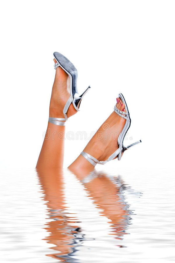 Woman legs in water royalty free stock images