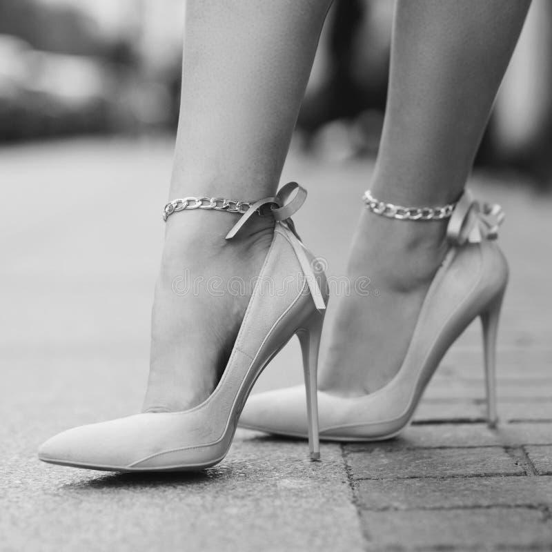 Woman legs wearing high heels royalty free stock photos