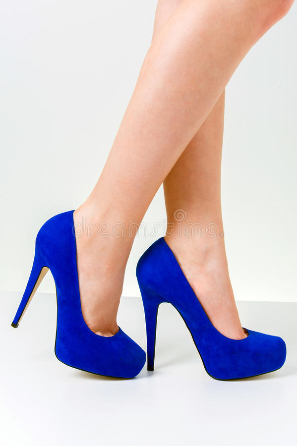 Woman legs wearing shoes royalty free stock photo