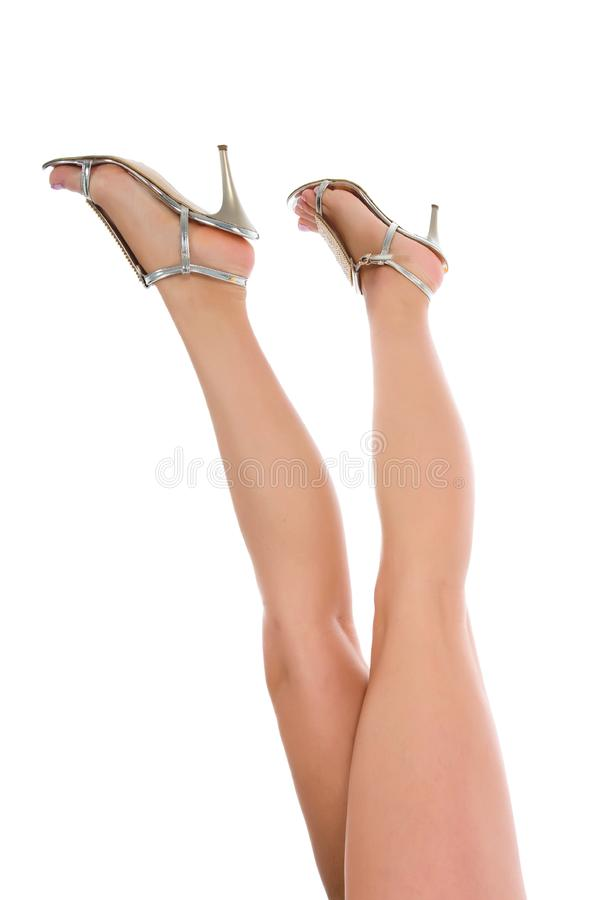 Woman legs on white stock image