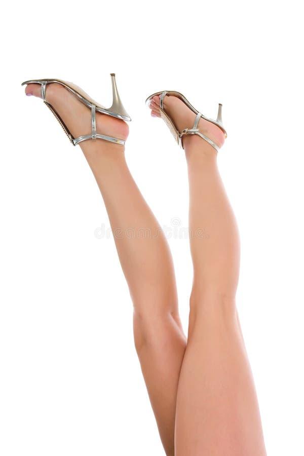 Woman legs on white stock image