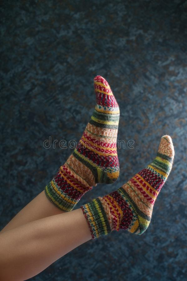 Woman legs in wool knitted socks royalty free stock photo