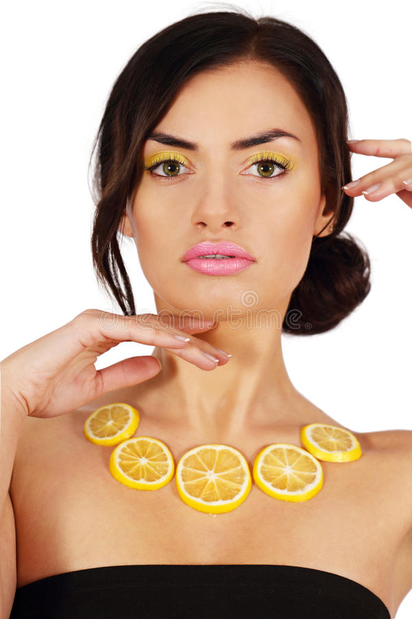 Woman with a lemon necklace royalty free stock images