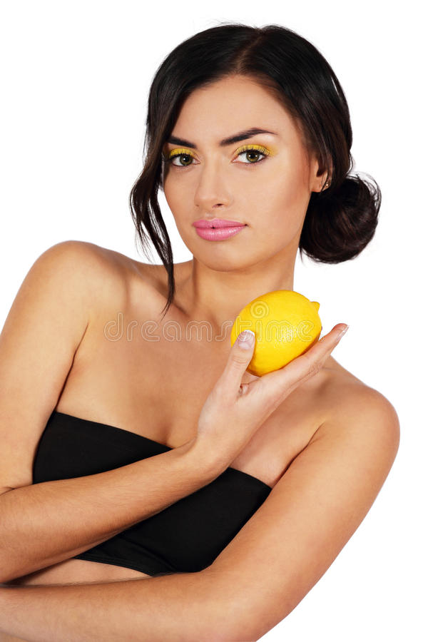 Woman with a lemon royalty free stock photos