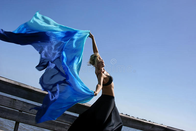 Woman letting silk fly stock photos