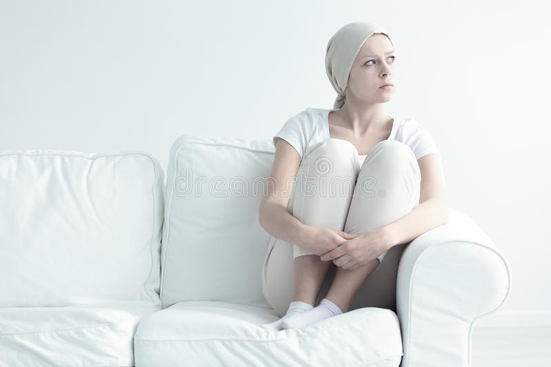 Woman with leukemia. Pensive woman with leukemia looking somewhere without hope royalty free stock photography